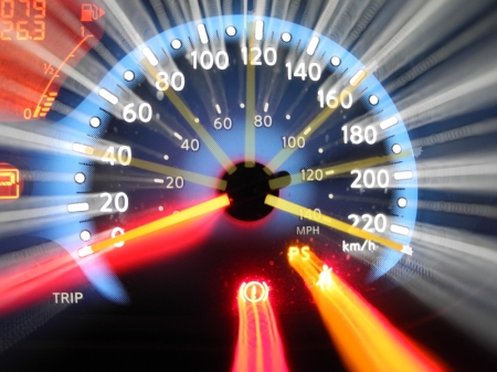 A zoom-exposure of a car's tachometer showing rapid acceleration from 0 to top-end speed (over 220 km/hr).